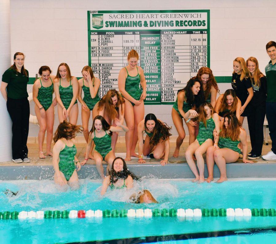 Junior varsity and varsity swim team celebrating their success this season. Courtesy of Kalyna Carroll '18.