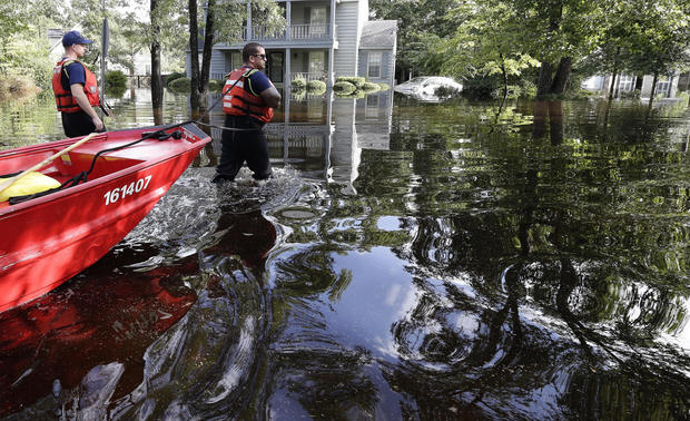 Members of the United States Coast Guard Shallow Water Rescue Team waddle through a flooded neighborhood in Lumberton, North Carolina, September 17. Courtesy of cbsnews.com. Gerry Broome, AP