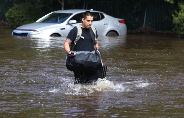 A resident of Spring Lake, North Carolina, evacuates from his apartment September 18. Courtesy of cbsnews.com. Joe Radele, Getty