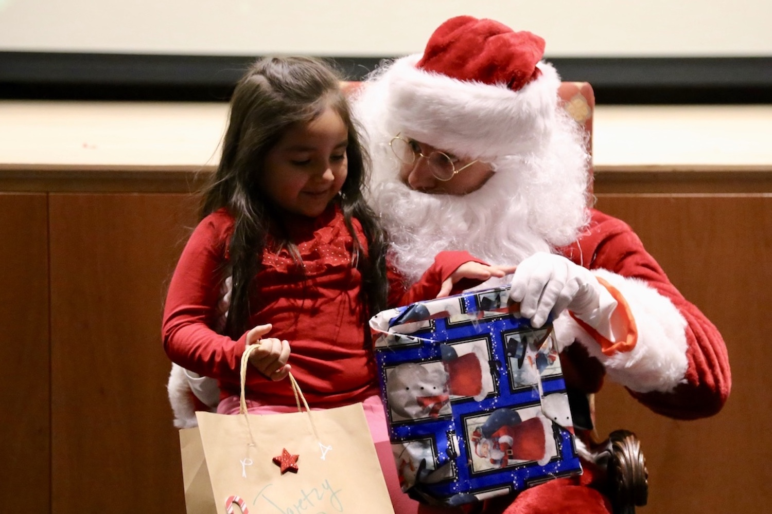 Children from the Carver Center came to Sacred Heart in 2017 to receive student-donated presents from Santa Claus.