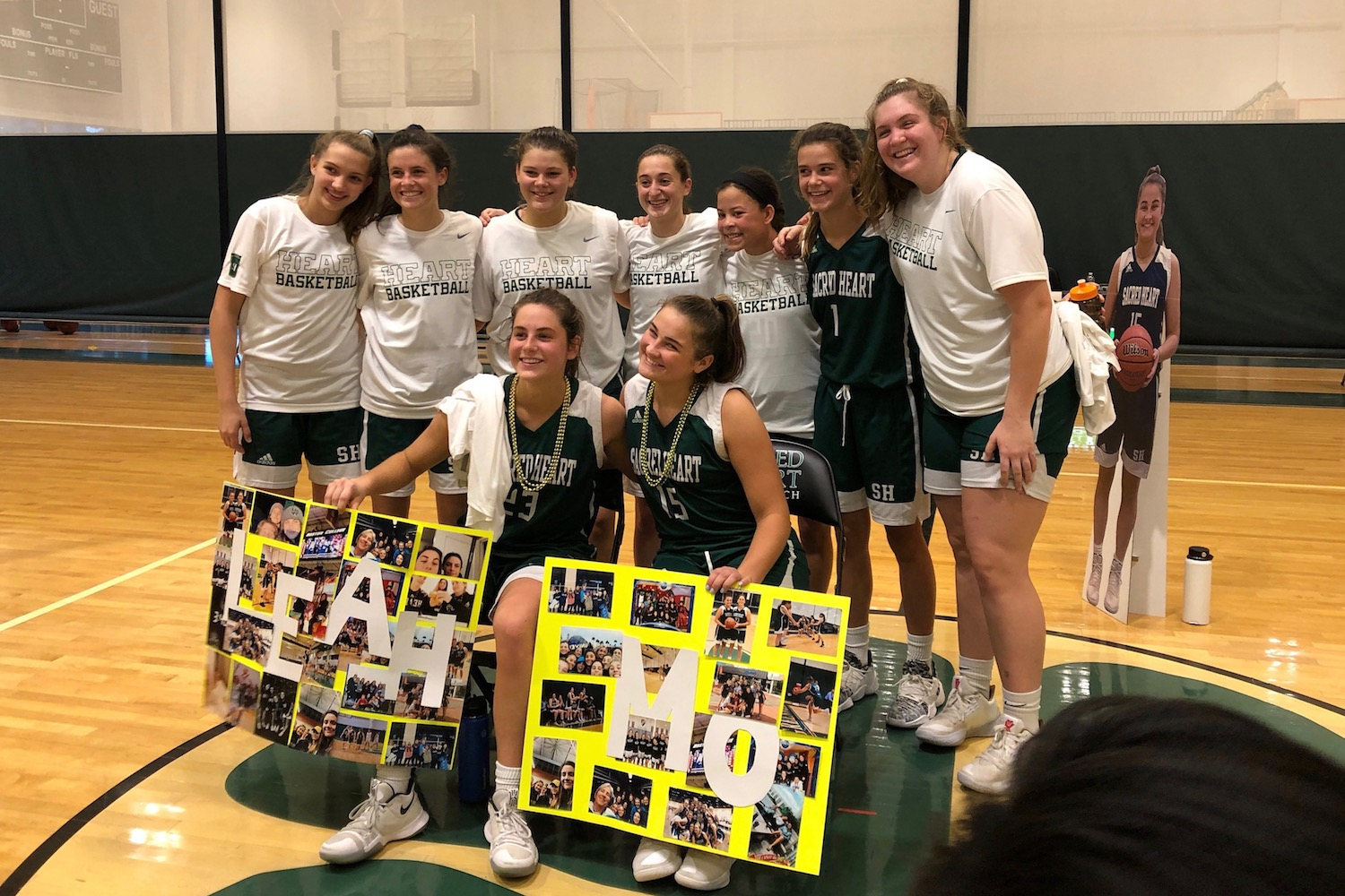 The varsity basketball underclassmen honor captains Morgan Smith '20 and Leah Atkins '20 during their senior day game.