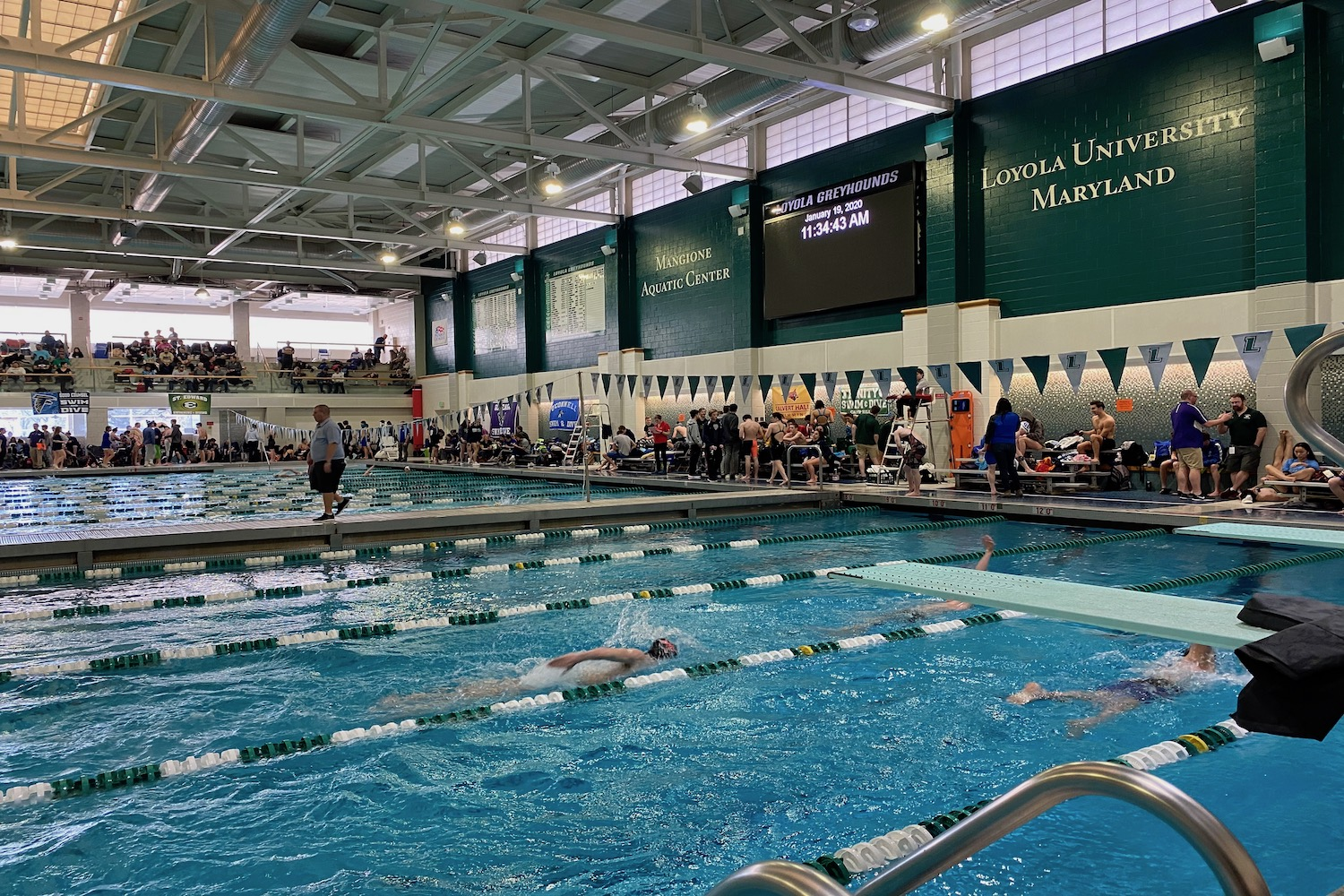 Swimmers race during the National Catholic  Swimming Championship meet at the Mangione Aquatic Center.