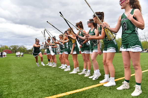 The lacrosse team cheering and preparing for a game.  Courtesy of Chris Pope Photography.